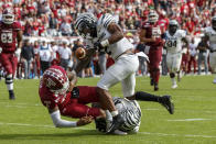 Memphis defensive back T.J. Carter (2) strips the ball away from Temple quarterback Todd Centeio (16) as he is tackled by Memphis linebacker JJ Russell (23) during the second half of an NCAA college football, Saturday, Oct. 12, 2019, in Philadelphia. Temple won 30-28. (AP Photo/Chris Szagola)