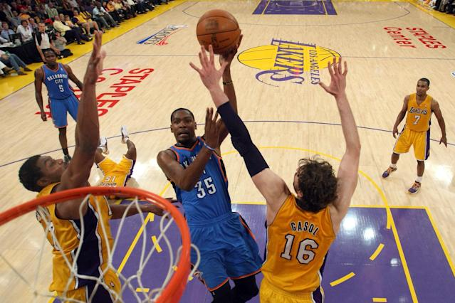 LOS ANGELES, CA - MAY 19: Kevin Durant #35 of the Oklahoma City Thunder goes up for a shot between Andrew Bynum #17 and Pau Gasol #16 of the Los Angeles Lakers in the first half in Game Four of the Western Conference Semifinals in the 2012 NBA Playoffs on May 19 at Staples Center in Los Angeles, California. NOTE TO USER: User expressly acknowledges and agrees that, by downloading and or using this photograph, User is consenting to the terms and conditions of the Getty Images License Agreement. (Photo by Stephen Dunn/Getty Images)