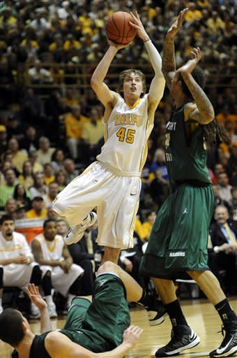 Valparaiso forward Ryan Broekhoff, left, puts a shot up around Wright State forward Tavares Sledge during second half in a NCAA college basketball game for the Horizon League Championship Tuesday March 12, 2013 in Valparaiso, Ind. (AP Photo/Joe Raymond)