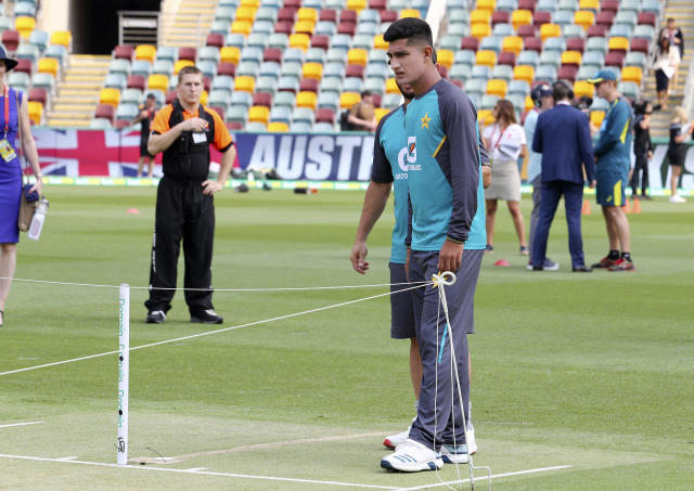 Pakistan's 16 year old Naseem Shah inspects the pitch before the first cricket test match in Brisbane, Australia, Thursday, Nov. 21 2019. (AP Photo/Tertius Pickard)