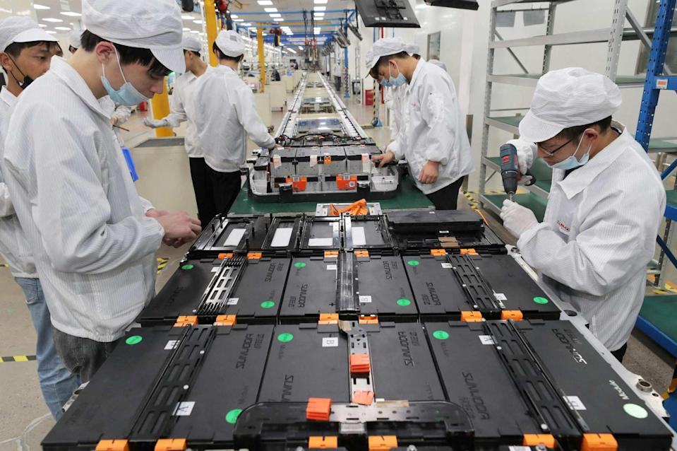 Workers at a factory for Xinwangda Electric Vehicle Battery seen making lithium battery packs for electric cars and other uses, in Nanjing, in China's eastern Jiangsu province. Photo: AFP