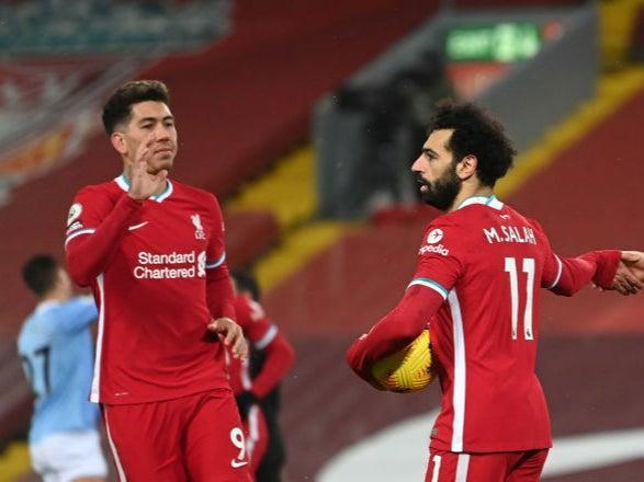 Mohamed Salah is congratulated by Roberto Firmino (Getty)