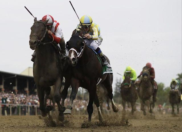 Cloud Computing beats Classic Empire by a nose to win the Preakness Stakes. (AP)