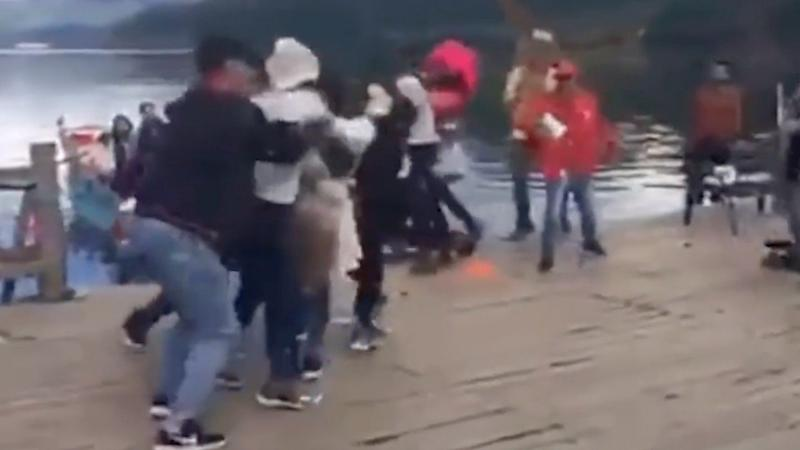 076c981e11b0 Brawl breaks out after Chinese tourists throw melon seed shells into lake