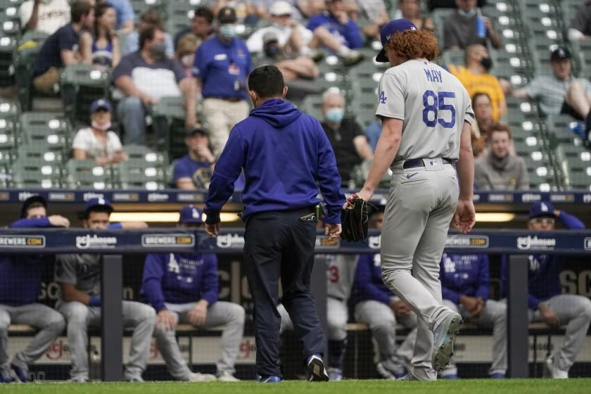 Dodgers pitcher Dustin May leaves the game after suffering an arm injury in the second inning at Milwaukee on May 1, 2021.