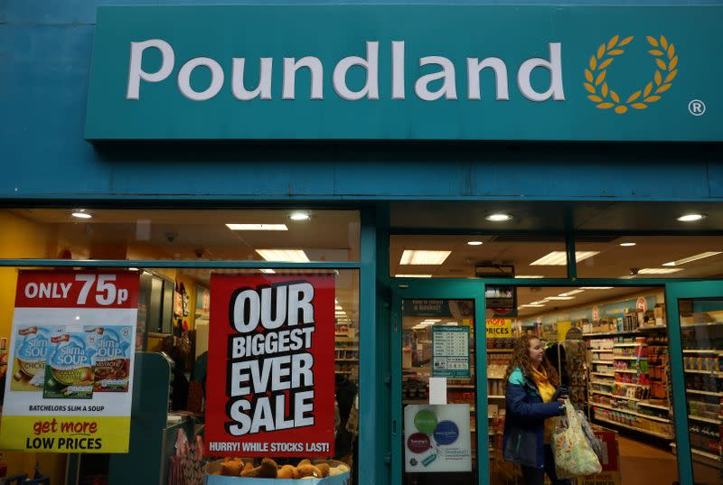 FILE PHOTO: A woman leaves a branch of Poundland in Altrincham, Britain