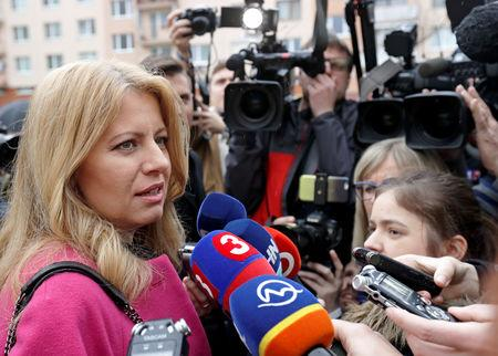 FILE PHOTO: Slovakia's presidential candidate Zuzana Caputova speaks to media after casting her vote during the country's presidential elections at a polling station in Pezinok, Slovakia, March 16, 2019. REUTERS/David W Cerny/File Photo