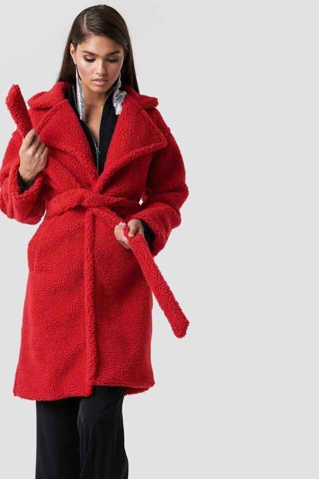 "This red coat has a button closure, side pockets and a removable waist belt. <strong><a href=""https://fave.co/31cjPIS"" target=""_blank"" rel=""noopener noreferrer"">Find it for $118 at NA-KD</a></strong>."