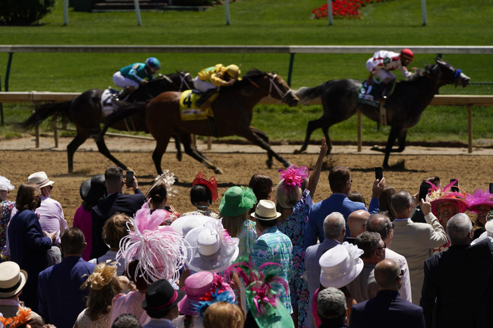 Fans watch race six before 147th running of the Kentucky Oaks at Churchill Downs, Friday, April 30, 2021, in Louisville, Ky. (AP Photo/Charlie Riedel)