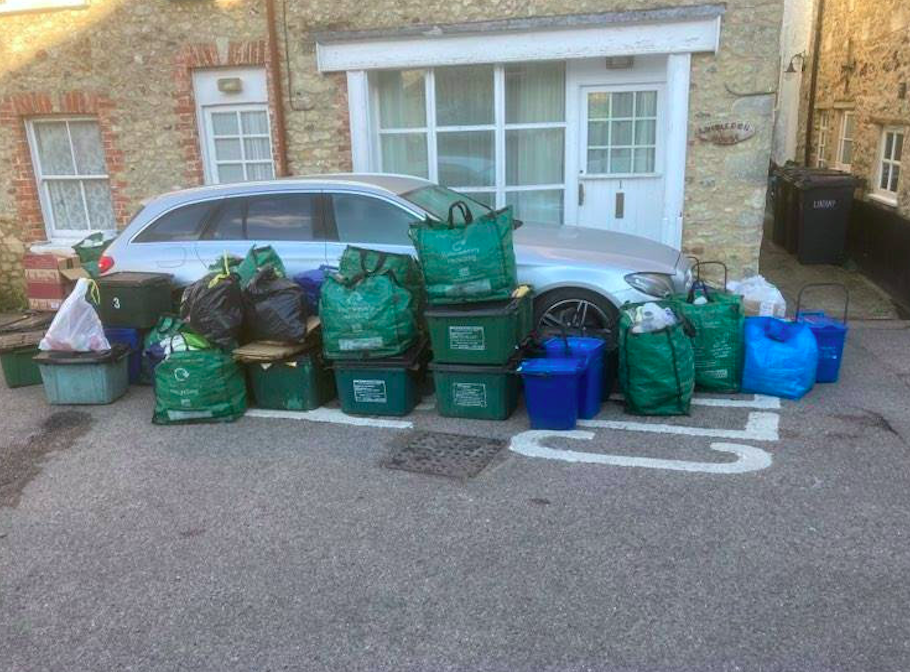 Residents surrounded the car with rubbish bags after it blocked binmen entering their road. (SWNS)