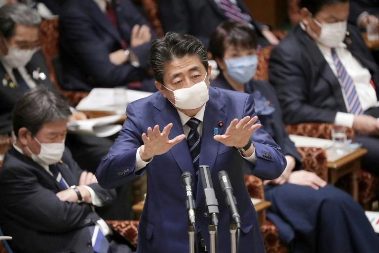 Japan's prime minister has in recent days begun sporting a small apparently homemade cloth mask