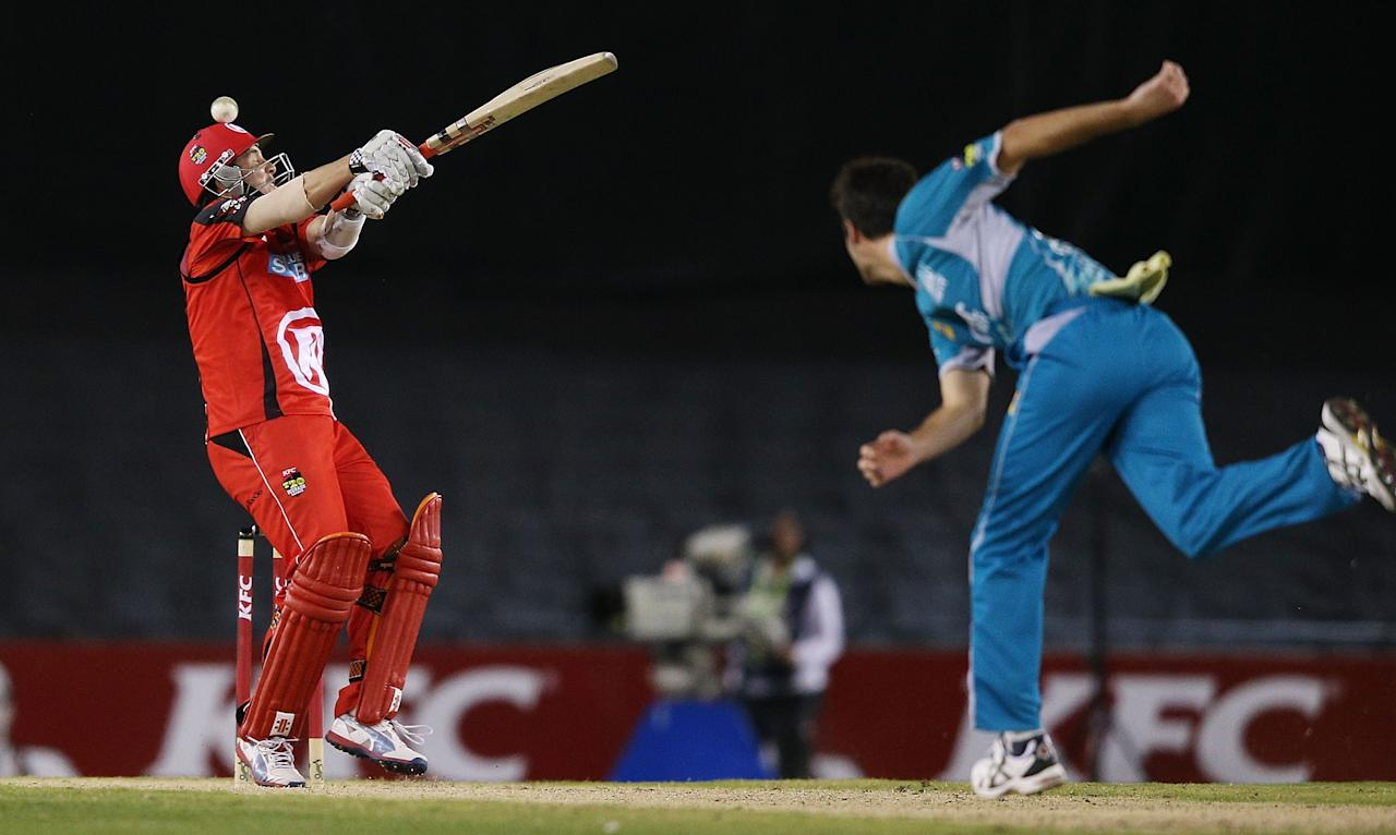 MELBOURNE, AUSTRALIA - DECEMBER 22:  Tom Cooper of the Renegades misses a shot off the bowling of Ben Cutting of the Heat during the Big Bash League match between the Melbourne Renegades and the Brisbane Heat at Etihad Stadium on December 22, 2012 in Melbourne, Australia.  (Photo by Michael Dodge/Getty Images)