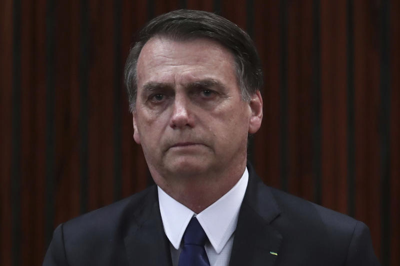 FILE - In this Monday, Dec. 10, 2018 file photo, President-elect Jair Bolsonaro cries during the playing of the national anthem at a ceremony officially confirming his election at the Supreme Electoral Court in Brasilia, Brazil. On Friday, March 27, 2020, The Associated Press reported on a photo circulating online incorrectly captioned as Italy's president with tears streaming down his face while saying the country has run out of space to bury the dead who have succumbed to coronavirus. The mis-captioned photo shows Bolsonaro crying during a Dec. 17, 2019, appearance while discussing the stabbing attack he was a victim of during his 2018 presidential campaign. (AP Photo/Eraldo Peres)