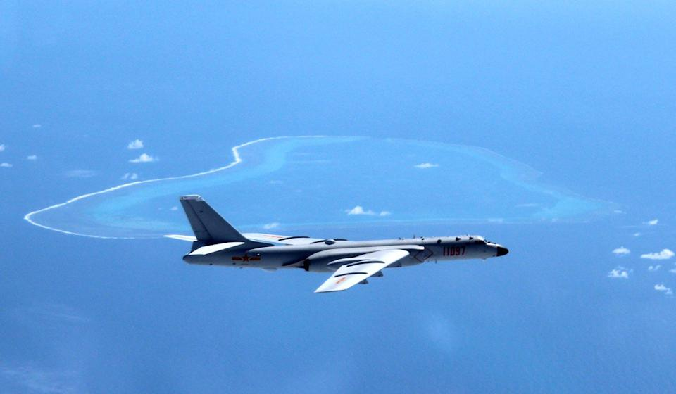 A Chinese bomber flies over Scarborough Shoal. Photo: Xinhua
