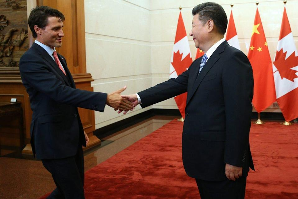 China's President Xi Jinping, right, shakes hands with Prime Minister Justin Trudeau before their meeting at the Diaoyutai State Guesthouse in Beijing, China, on Aug. 31, 2016. (Wu Hong/Pool Photo via AP)