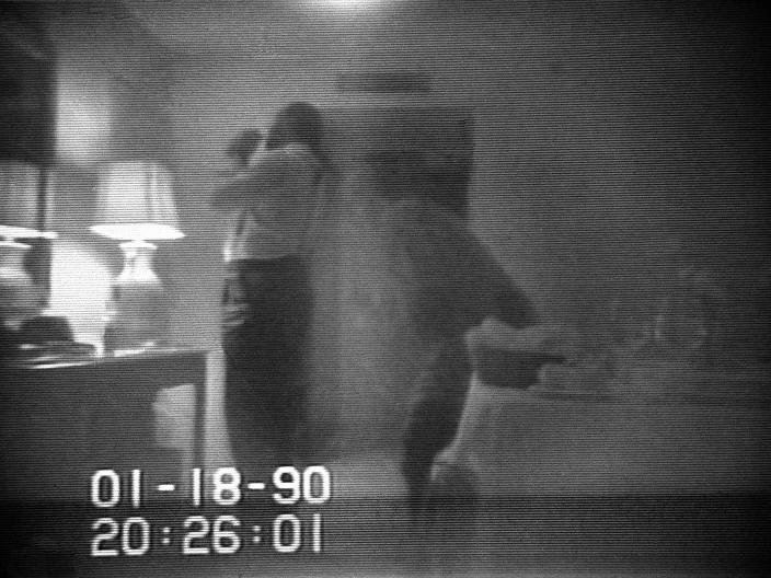 This file frame from a black-and-white FBI videotape shows Washington Mayor Marion Barry allegedly lighting a crack cocaine pipe in a Washington hotel room in January 18, 1990 as Rasheeda Moore stands behind him. (Barry Thumma/AP)
