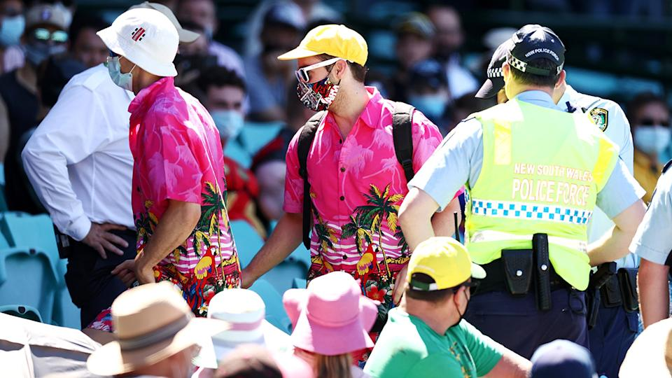 Police speak to spectators following a complaint from Mohammed Siraj of India that stopped play during day four of the Third Test match in the series between Australia and India at the SCG. (Photo by Cameron Spencer/Getty Images)