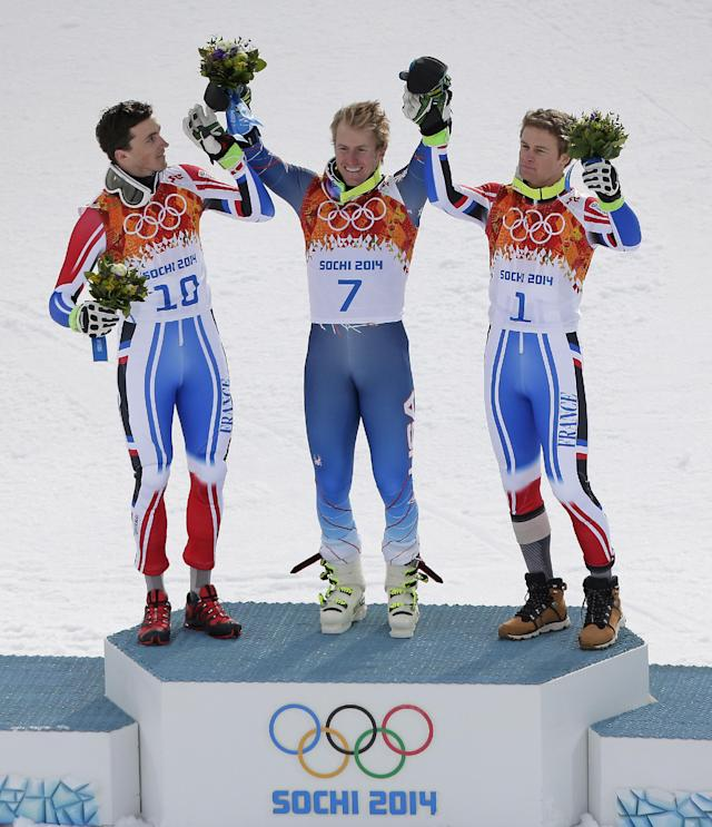 Men's giant slalom medalists, from left, France's Steve Missillier (silver), United States' Ted Ligety (gold) and France's Alexis Pinturault (bronze) pose for photographers on the podium at the Sochi 2014 Winter Olympics, Wednesday, Feb. 19, 2014, in Krasnaya Polyana, Russia. (AP Photo/Charlie Riedel)