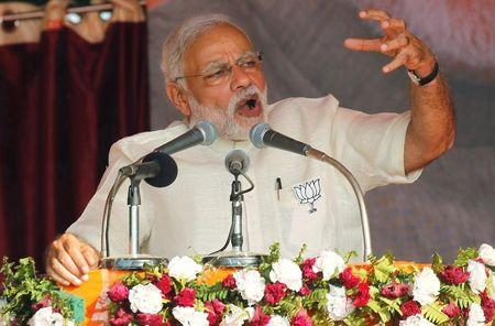 India's Prime Minister Narendra Modi gestures as he addresses an election campaign rally in Allahabad