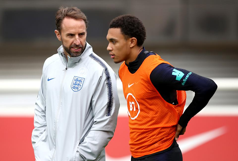 File photo dated 06-09-2019 of England manager Gareth Southgate (left) speaks with Trent Alexander-Arnold. Issue date: Tuesday May 25, 2021.