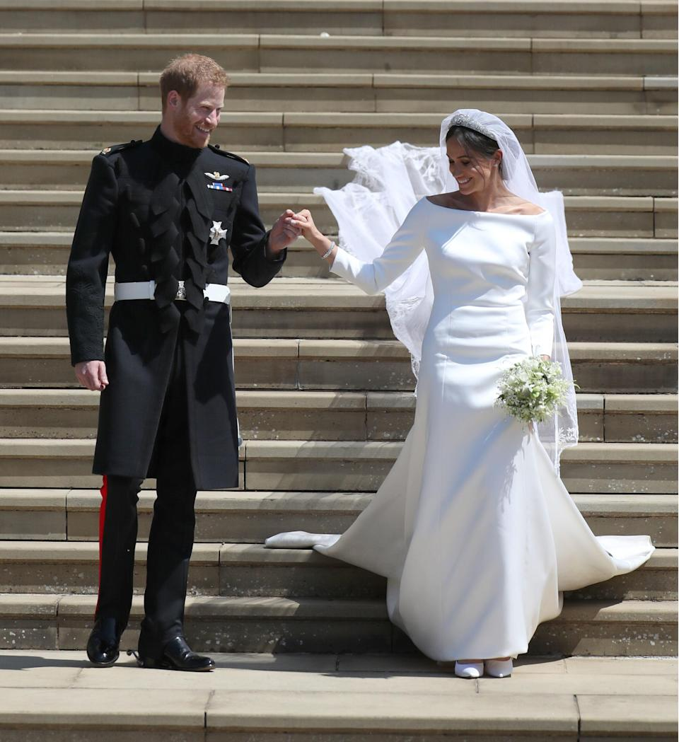 The beautiful moment Meghan's veil trickled down the West Steps of St George's Chapel [Photo: Getty]