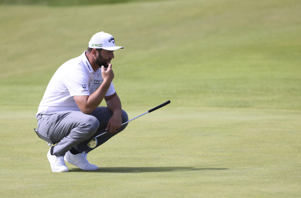 Spain's Jon Rahm looks at the line of his putt on the 3rd green during the first round British Open Golf Championship at Royal St George's golf course Sandwich, England, Thursday, July 15, 2021. (AP Photo/Ian Walton)