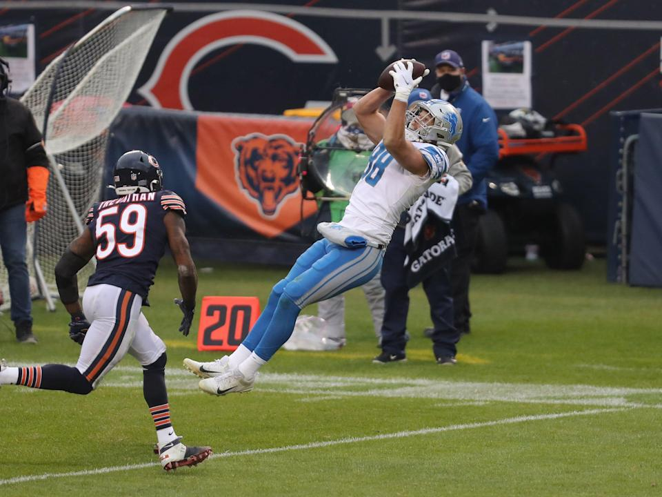 Detroit Lions tight end T.J. Hockenson catches a pass in front of Chicago Bears linebacker Danny Trevathan during the second half at Soldier Field, Dec. 6, 2020 in Chicago.