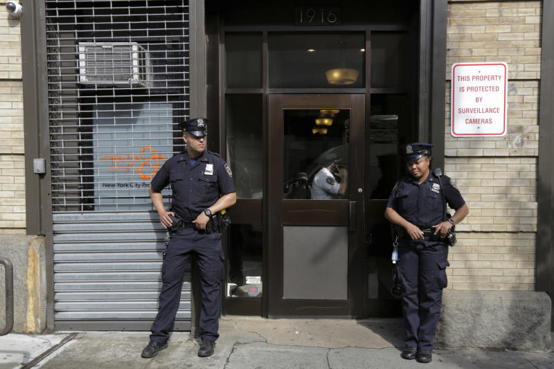 CORRECTS TO LOCATION HARLEM NOT BROOKLYN - FILE - In this Thursday, June 21, 2018 file photo, police stand outside an office for the Cayuga Centers in the the Harlem neighborhood of New York. Three of the four incidents involving physical harm to separated immigrant children, outlined in legal filings, involved charges of Cayuga Centers, the largest foster care placement for migrant children. (AP Photo/Richard Drew)