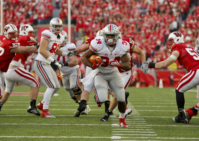 Ohio State running back Carlos Hyde (34) scores on a touchdown run against Wisconsin during the first half of an NCAA college football game Saturday, Nov. 17, 2012, in Madison, Wis. (AP Photo/Andy Manis)