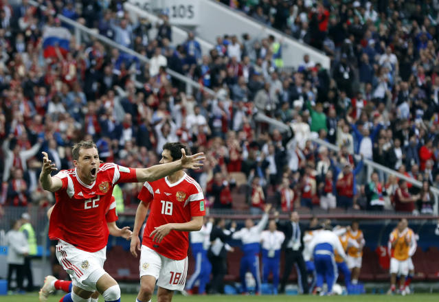 Russia's Artyom Dzyuba celebrates after scoring his side's third goal during the group A match between Russia and Saudi Arabia which opens the 2018 soccer World Cup at the Luzhniki stadium in Moscow, Russia, Thursday, June 14, 2018. (AP Photo/Pavel Golovkin)