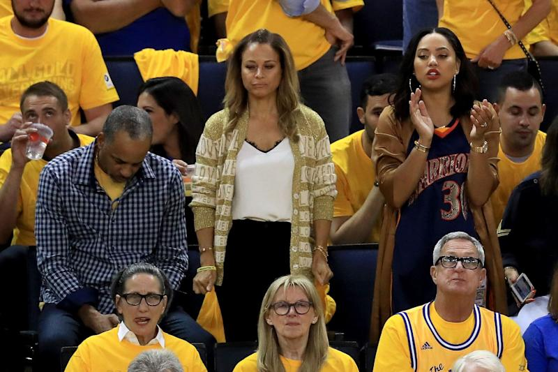 OAKLAND, CA - JUNE 12: (L-R) Dell and Sonya Curry, parents of Stephen Curry #30 of the Golden State Warriors sit with his wife Ayesha Curry in the stands during Game 5 of the 2017 NBA Finals between the Golden State Warriors and the Cleveland Cavaliers at ORACLE Arena on June 12, 2017 in Oakland, California. NOTE TO USER: User expressly acknowledges and agrees that, by downloading and or using this photograph, User is consenting to the terms and conditions of the Getty Images License Agreement. (Photo by Ronald Martinez/Getty Images)