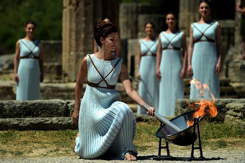 Actress Katerina Lechou acting as the high priestess lights the Olympic flame at the Temple of Hera in ancient Olympia, the sanctuary where the Olympic Games were born, during the lighting ceremony on April 21, 2016