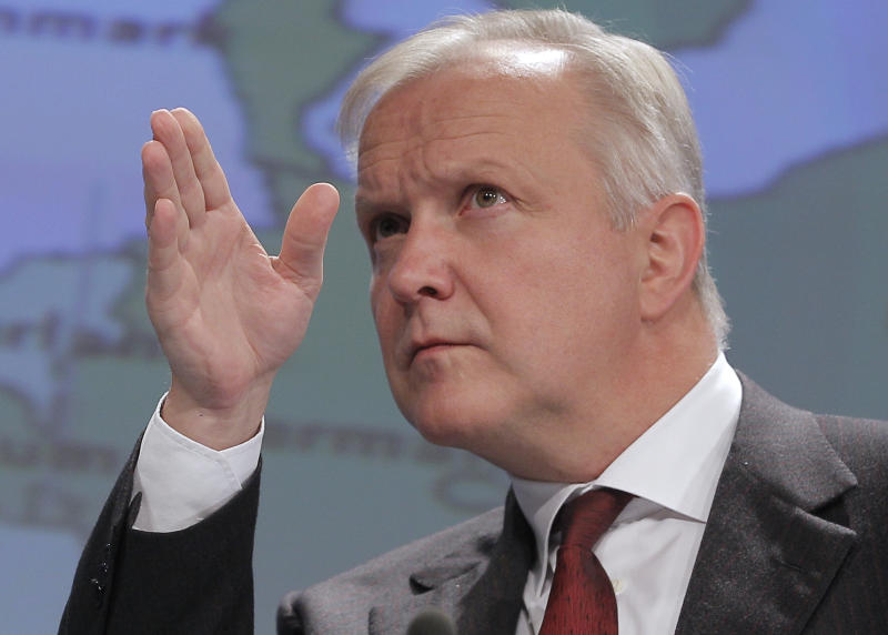 European Commissioner for Economic and Monetary Affairs Olli Rehn addresses the media at the European Commission headquarters in Brussels, Tuesday Nov. 5, 2013. The European Commission says in its latest forecast the 28-nation bloc's economic recovery is underway thanks to tepid but continuing growth in the second half of the year. (AP Photo/Yves Logghe)