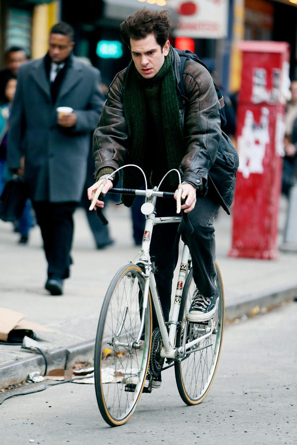 <p>Andrew Garfield rides a bike while filming a scene for Lin Manuel Miranda's <i>Tick, Tick, Boom</i> in N.Y.C. on Tuesday. </p>