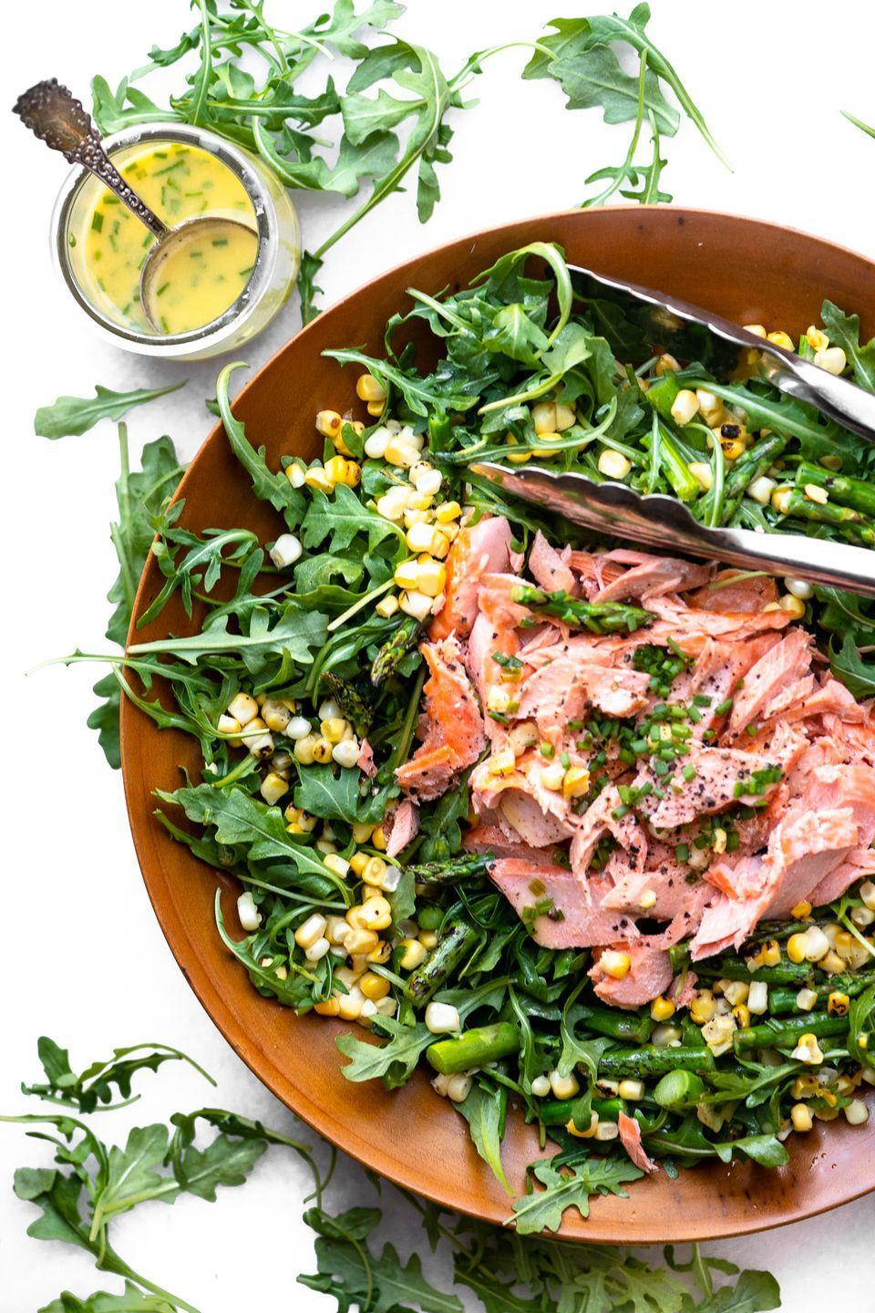 "<p>Looking for a refreshing salad this summer? Try this salmon salad that's bursting with flavor from blistered fresh corn.</p><p><strong>Get the recipe from <a href=""https://theviewfromgreatisland.com/blistered-corn-and-asparagus-salad-with-salmon-recipe/"" rel=""nofollow noopener"" target=""_blank"" data-ylk=""slk:The View from Great Island"" class=""link rapid-noclick-resp"">The View from Great Island</a>.</strong></p><p><strong><a class=""link rapid-noclick-resp"" href=""https://go.redirectingat.com?id=74968X1596630&url=https%3A%2F%2Fwww.walmart.com%2Fsearch%2F%3Fquery%3Dtongs&sref=https%3A%2F%2Fwww.thepioneerwoman.com%2Ffood-cooking%2Fmeals-menus%2Fg35993911%2Fbest-corn-recipes%2F"" rel=""nofollow noopener"" target=""_blank"" data-ylk=""slk:SHOP TONGS"">SHOP TONGS</a><br></strong></p>"