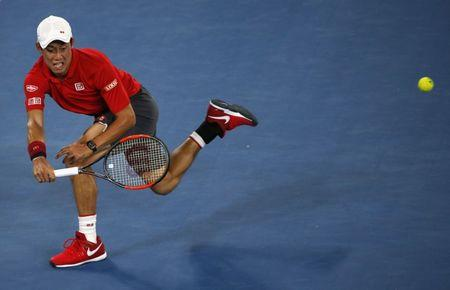 Tennis - Australian Open - Melbourne Park, Melbourne, Australia - 22/1/17 Japan's Kei Nishikori hits a shot during his Men's singles fourth round match against Switzerland's Roger Federer. REUTERS/Issei Kato