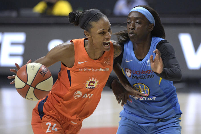 Connecticut Sun forward DeWanna Bonner drives to the basket in front of Chicago Sky guard Kahleah Copper during the second half of their first-round playoff game Tuesday, Sept. 15, 2020, in Bradenton, Fla. (AP/Phelan M. Ebenhack)