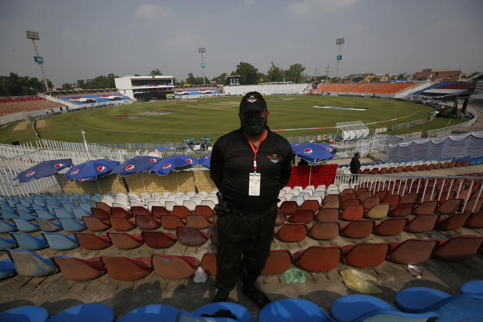 A Pakistani police officer stands guard an enclosure of the Pindi Cricket Stadium before the stat of the first one day international cricket match between Pakistan and New Zealand at the Pindi Cricket Stadium, in Rawalpindi, Pakistan, Friday, Sept. 17, 2021. The limited-overs series between Pakistan and New Zealand has been postponed due to security concerns of the Kiwis. (AP Photo/Anjum Naveed)
