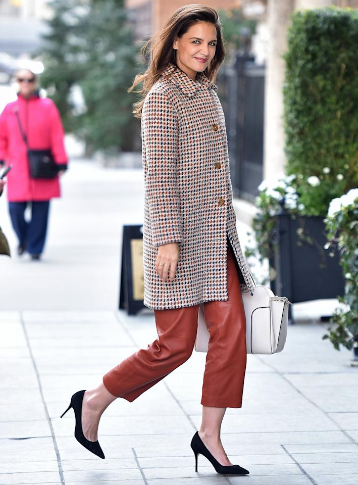 """<p>I'm on the hunt for an """"investment bag."""" Who makes this one Katie's wearing? —Hannah  Katie's handbag is from Tod's, comes in an array of neutrals, and certainly meets the criteria for an """"investment bag!"""" </p>"""