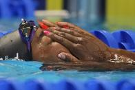 Simone Manuel reacts after the women's 50 freestyle during wave 2 of the U.S. Olympic Swim Trials on Sunday, June 20, 2021, in Omaha, Neb. (AP Photo/Charlie Neibergall)