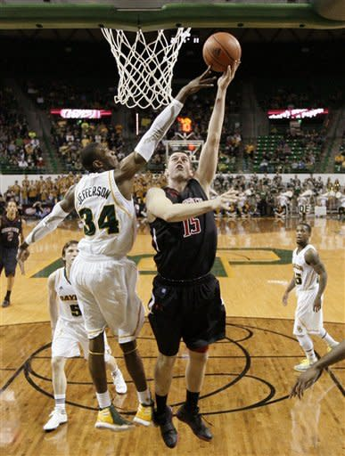 Texas Tech 's Robert Lewandowski (15) attempts a shot as Baylor 's Cory Jefferson (34) defends in the first half of an NCAA college basketball game Monday, Feb. 27, 2012, in Waco, Texas. (AP Photo/Tony Gutierrez)