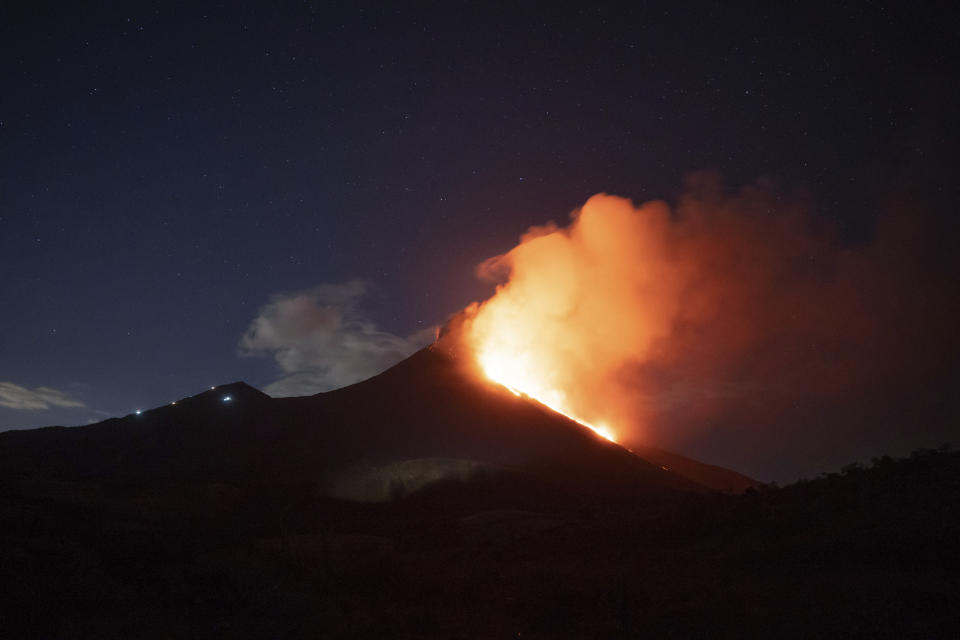 Pacaya volcano spews lava, viewed from San Vicente Pacaya, Guatemala, Wednesday, March 3, 2021. (AP Photo/Santiago Billy )