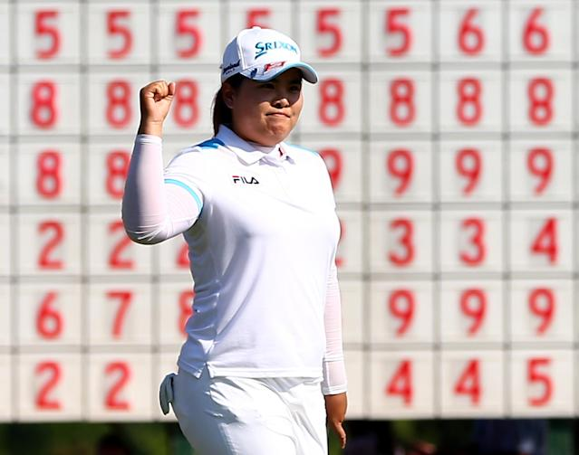 IRVING, TX - APRIL 28: Inbee Park of South Korea celebrates after sinking a birdie putt during the final round to win the 2013 North Texas LPGA Shootout at the Las Colinas Counrty Club on April 28, 2013 in Irving, Texas. (Photo by Tom Pennington/Getty Images)