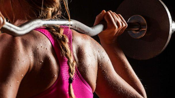 PHOTO: Woman holding red dumbbells. Workout (STOCK PHOTOS/Getty Images)