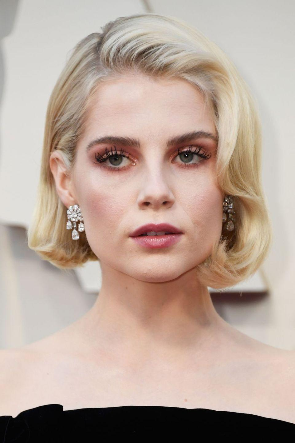 <p>Lucy Boynton opted for a rosy-hued monochrome make-up look for the 2019 Oscars.</p>