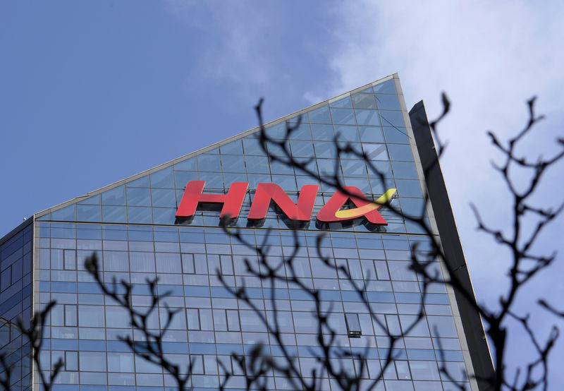 A HNA Group logo is seen on the building of HNA Plaza in Beijing