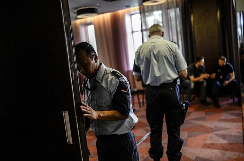 Members of the Dutch forensic team arrive for a meeting in the centre of Donetsk, eastern Ukraine, on July 27, 2014 (AFP Photo/Bulent Kilic)