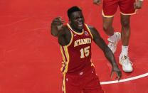 Atlanta Hawks center Clint Capela (15) reacts after a play against New York Knicks forward Julius Randle (30) during the second half in Game 3 of an NBA basketball first-round playoff series Friday, May 28, 2021, in Atlanta. (AP Photo/Brynn Anderson)