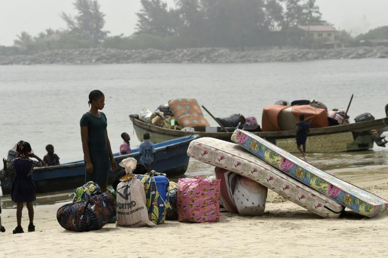 Navy personnel last week shot in the air and bulldozed houses as they cleared a community of some 10,000 people living on an island in Lagos (AFP Photo/PIUS UTOMI EKPEI)