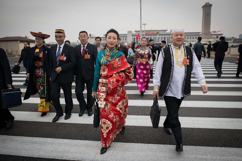 Delegates in ethnic dress were among those attending the National People's Congress (AFP Photo/NICOLAS ASFOURI)